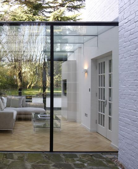 Glass cube extension. Here they have kept the retaining wall.