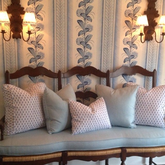 Blue & white throw pillows on a lovely French bench & Quadrille Climbing Hydrangea wallpaper in French Blue - Lee Ann Thornton
