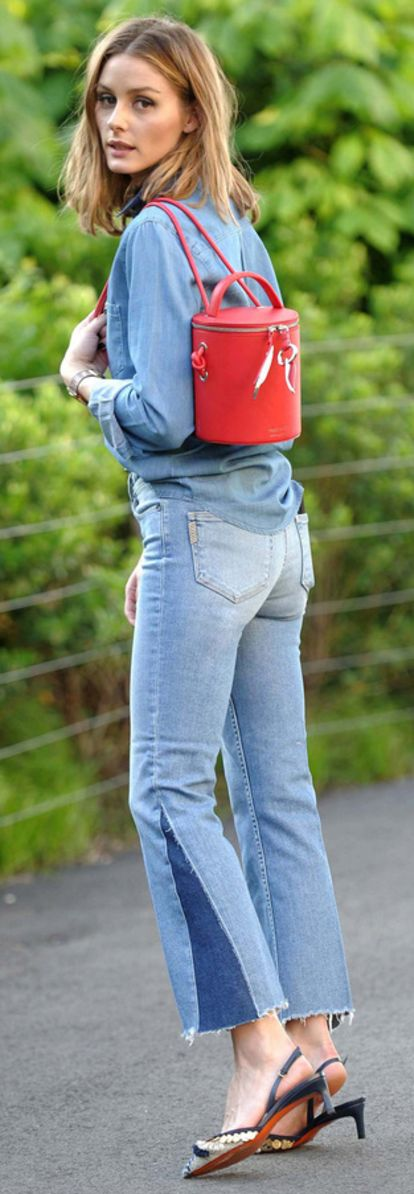 Who made Olivia Palermo's red bucket handbag, blue flared jeans, and beaded pumps?