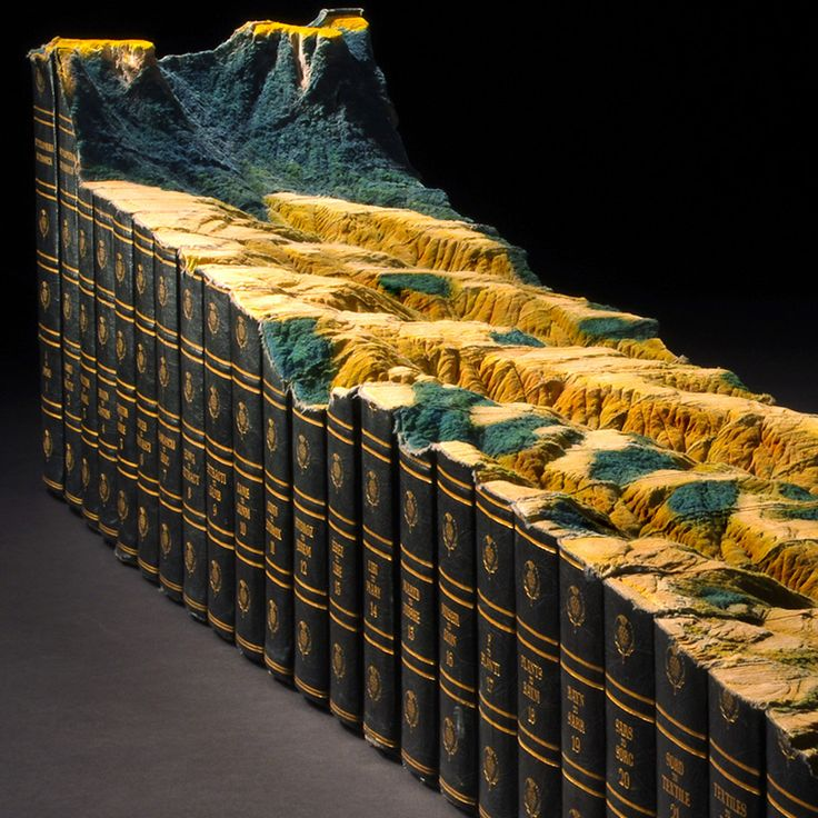 Artist Guy Laramée Carves a Mountainous Landscape from an Encyclopedia Britannica Set sculpture mountains books