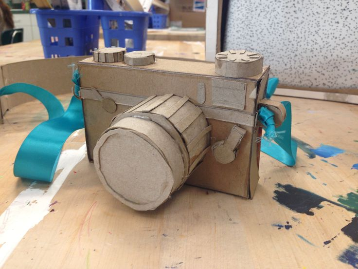 This sculpture was created by a 9th grade, female student in Fort Myers, Florida the spring of 2014. This was inspired by artist Kiel Johnson and his cardboard sculptures of camera's. The goal here was for the student to manipulate the cardboard into creating as many minute details as possible to create an exact replica this specific type of camera, while exploring the evolution of camera technology over the years.