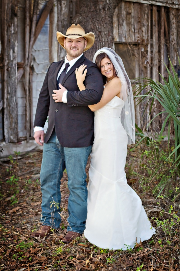 Country Wedding, complete with a cowboy groom! <3 Love how he is in jeans. Dressed up but comfty at the same time. LOVE it.