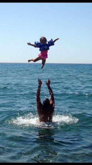 NIKI K. - UNITED STATES ΕΚΠΡΟΣΩΠΟΣ ΤΗΣ ΕΛΛΑΔΑΣ Summer fun enjoying the deap blue sea and black sand at Skala Eressos, Lesvos