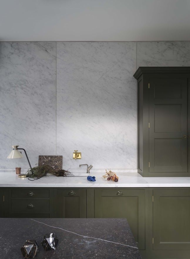 Plain English moss green kitchen cabinets with contrast of 2 types of marble counters
