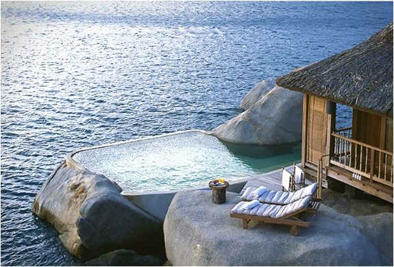 Six Senses is a Lavish hideaway on the dramatic Ninh Van Bay, there you can stay at one of the 58 pool villas and experience the legendary beauty of Vietnams most pristine beaches. The villas are tucked into a lush jungle-covered hill and nestled amid unique rock formations overlooking the East Vietnam Sea. The bay features a gorgeous coral reef, perfect for snorkeling enthusiasts.