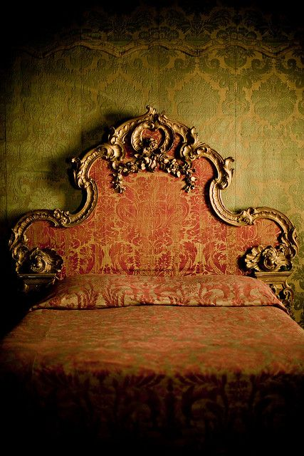 French gilded headboard with antique russet and bronze damask fabric. Olive and gold damask wall covering. We do have new fabrics which can replicate an Old World Look. DesignNashville.