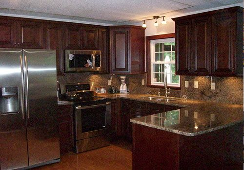 tan brown granite with dark cabinets | This American kitchen has dark reddish cabinets with superb granite ...I LIKE THAT THE TRIM AROUND THE WINDOW MATCHES THE CABINETS. NO NEED FOR A WINDOW TREATMENT THAT WAY