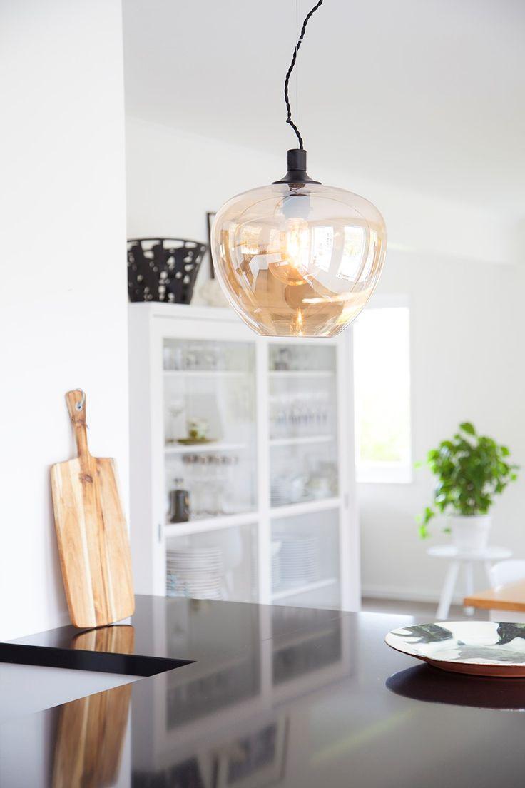 Transitional amber glass globe pendant Bellissimo  Click for detailed info