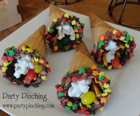 Ice Cream cornucopias filled with Charlie Brown Thanksgiving foods - jelly beans, pretzels and popcorn.