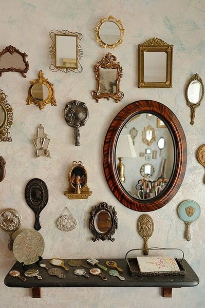 A pretty collection of mirrors and hand mirrors really looks nice on this wall.  Do you have a collection of hand mirrors?