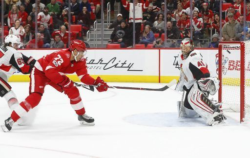 Detroit Red Wings' Andreas Athanasiou (72) scores on Ottawa Senators goaltender Craig Anderson (41) during overtime in an NHL hockey game Wednesday, Jan. 3, 2018, in Detroit. Detroit won 2-1. (AP Photo/Paul Sancya)