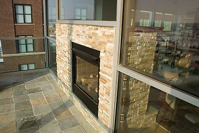 indoor/outdoor double-sided fireplace... pretty awesome!