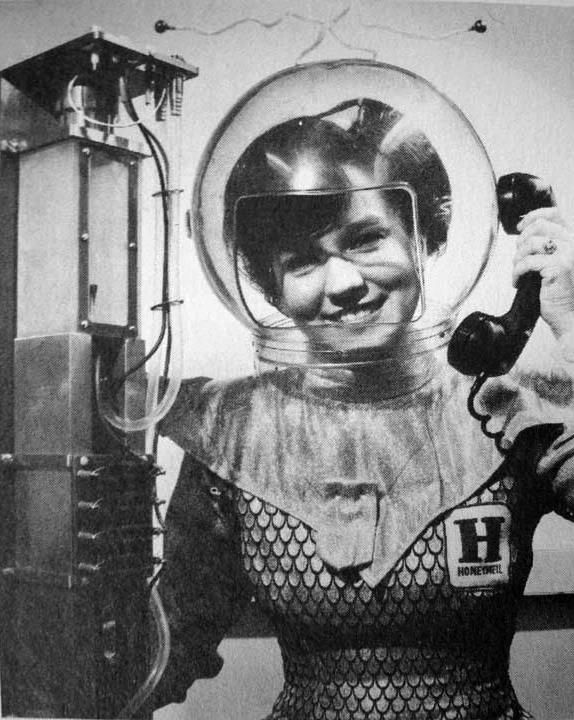 """""""1960's woman of the future uses a CO2 laser 'telephone' in this advertisement photograph by Honeywell Corp."""""""