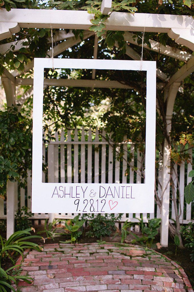 Use poster board and a box cutter to carve out the shape of a polaroid. Paint on your names and wedding date for a personalized touch. Photo by Love Ala via Style Me Pretty