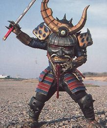 Samurai Org came out of a samurai outfit and is defeated by Alyssa using skills learned from her father. He was ultimately destroyed by the Kongazord. Samurai Org's spirit was among the six Org Spirits that Master Org used to create Tombstone Org.Sing Song