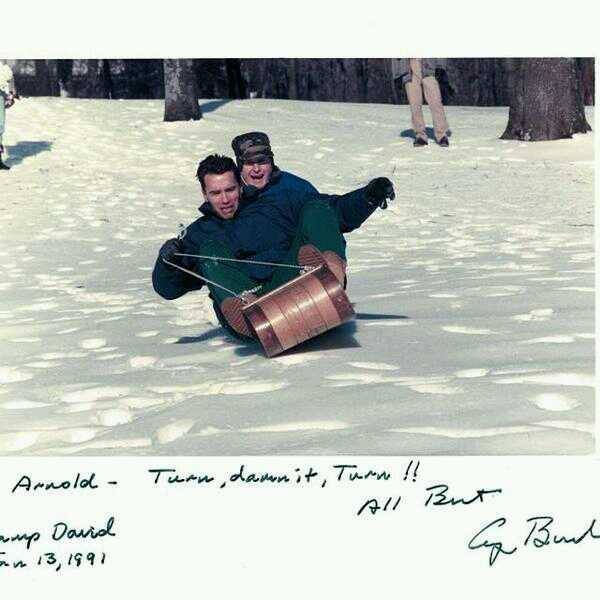 Arnold Schwarzenegger and former President George Bush sled riding.   Great times via SledRiding.com !!