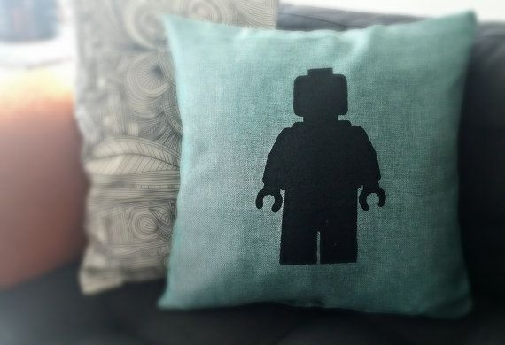 For Lego enthusiasts around the globe! Show off you love of minifigs by showcasing this modern hand silk screened minifig silhouette on a pillow on