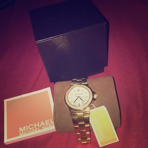 Michael Kors female watch Gold MK watch worn once or twice great conditions still box Michael Kors Jewelry Bracelets