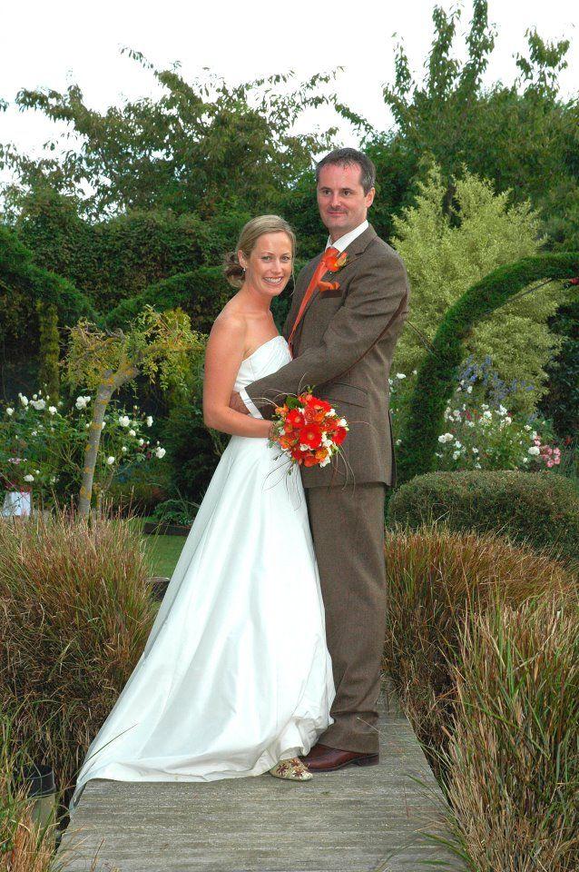 Happy couple married in Parkside Gardens Oamaru, South Island New Zealand.