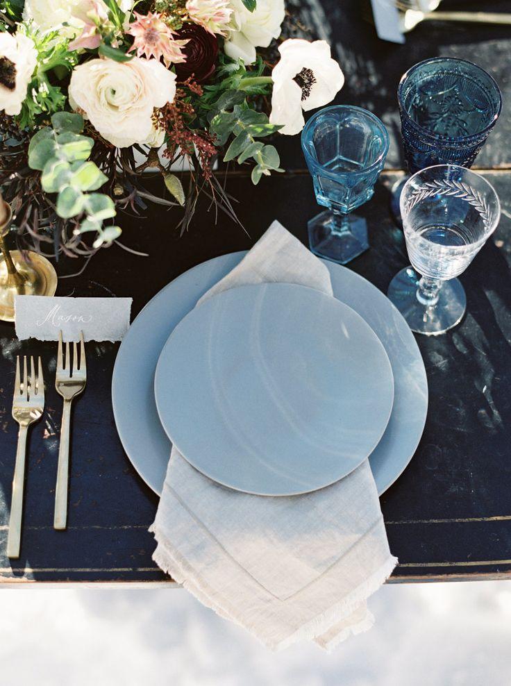 Blue table setting: Venue: Open Meadows Ranch - http://www.stylemepretty.com/portfolio/open-meadows-ranch Photography: Simply Sarah Photography - simplysarah.me   Read More on SMP: http://www.stylemepretty.com/2017/02/23/jackson-hole-winter-vow-renewal/
