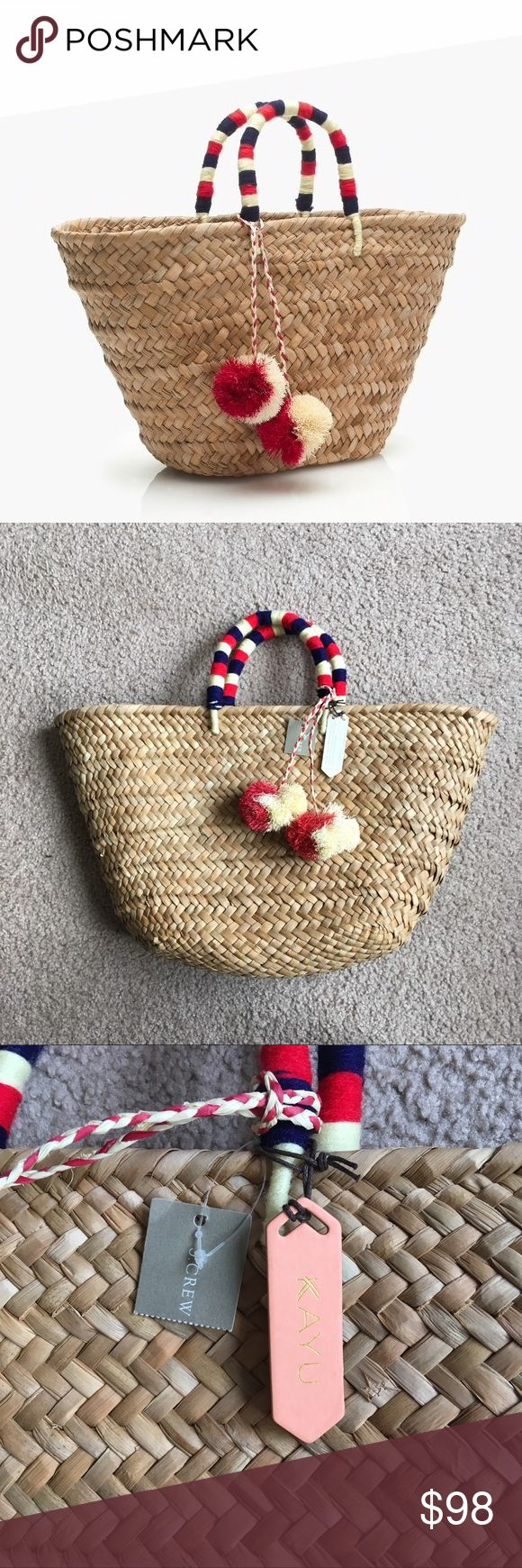 NEW J. Crew Kayu St. Tropez handmade woven tote NWT handcrafted Kayu St. Tropez beach tote bag in collaboration with J. Crew. Woven by female artisans in the Philippines. Red white and blue wrapped handles with red and cream pom pom tassels. The pom poms are a little squished from storage. See measurements in stock photo.  15% off 2+ bundles! J. Crew Bags Totes