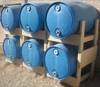 A 55 gallon barrel of water can weigh up to 450 lbs. How and where will you store it? Consider the water barrel stand. The schematics to make one of your own are included, or you can buy one.  It's a great way to save space and store water.  You could even store these in a shed.