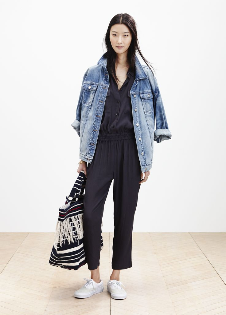 Madewell oversized jean jacket worn with the Pull-On jumpsuit + woven beach tote. See something you like? Pre-order your favorite pieces by phone (866 544 1937) or email shopfirst@madewell.com. #springmadewell