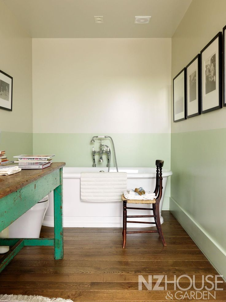 The guest bathroom's two-tone paint finish is a modern take on a classical dado; the London Round bath is from Burlington, with an old French kitchen table at left. - See more at: http://nzhouseandgarden.co.nz/strength-to-strength/#sthash.V88pmDNP.dpuf