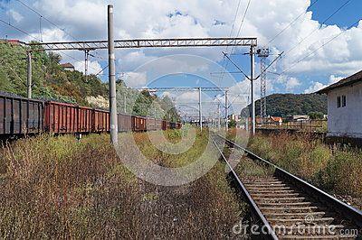 Landscape with railroad rails and train, Romania