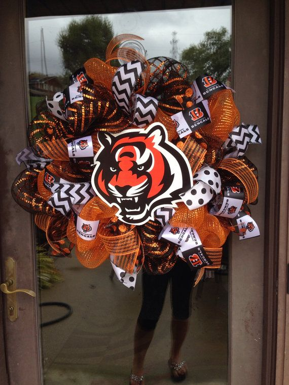 Keep in mind not all wreaths are the exact same!! They are all very similar!! 24 inches light weight and perfect for a bengals fan! Also keep