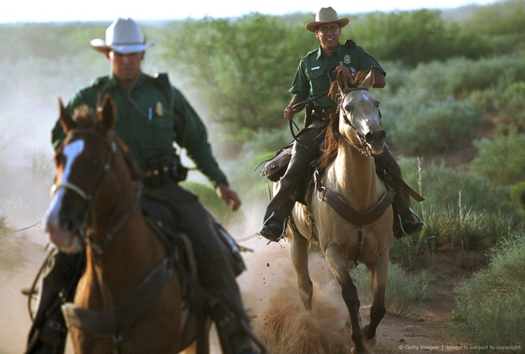 Image detail for -U.S. Border horse patrol agents from the El Paso, Texas sector ride alongside the guarded U.S. border September 10, 1999. They are part of a group of 18 that ride horses as they patrol the U.S. border
