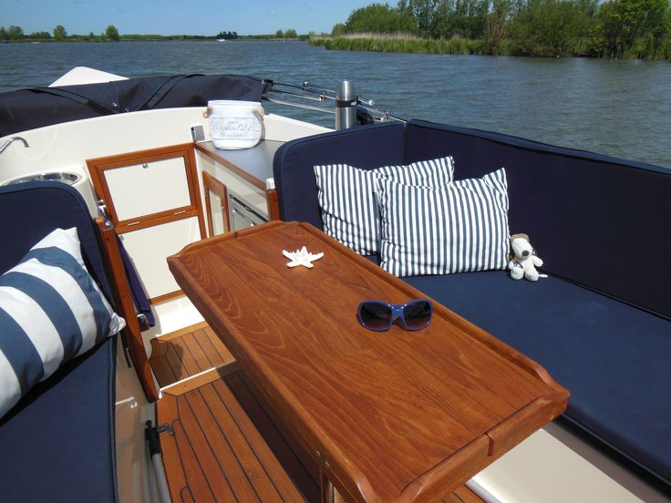 Slip covers for pontoon boat in navy. Navy and white stripe pillows made from beach towels. or could use green.