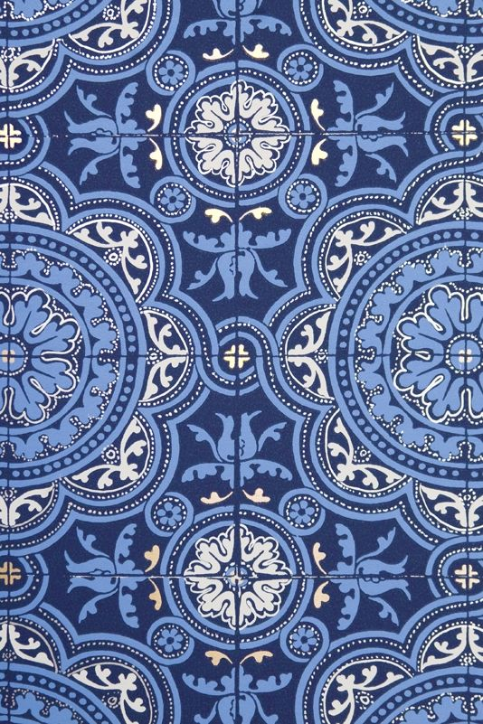 Piccadilly Wallpaper Turkish inspired tiled effect wallpaper in rich blues and white, The paper is further embellished with subtle gold and silver detail.
