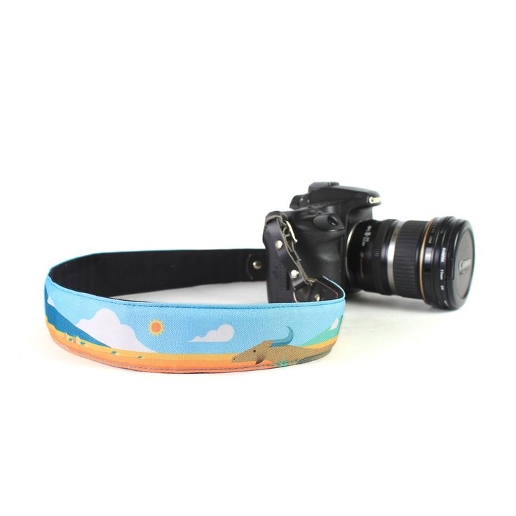 Punchdrunk Panda Camera Strap - {Land} - An escape from the hustle and bustle of the city is exactly what you need every once in a while. Plus 63's Dan Matutina paints a serene picture of a sunny mountain getaway, complete with a carabao silently grazing in the distance. Available in 2 sizes. Price starts from Php495. #punchdrunkpanda #photography #camerastrap