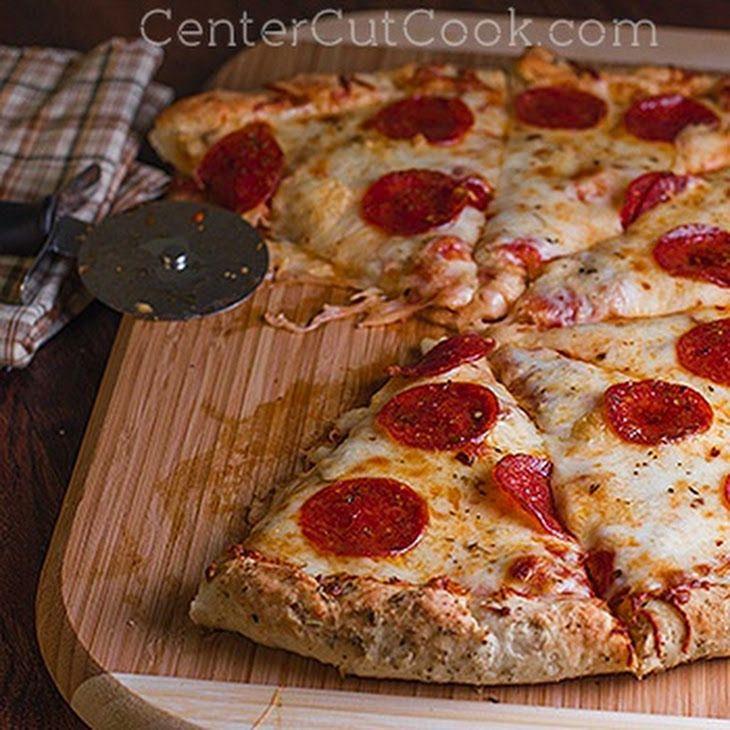Fast & Easy Pizza Dough Recipe Main Dishes with rapid rise yeast, warm water, all-purpose flour, honey, salt, olive oil, olive oil, basil, italian seasoning, garlic powder, oregano, mozzarella cheese, pizza sauce