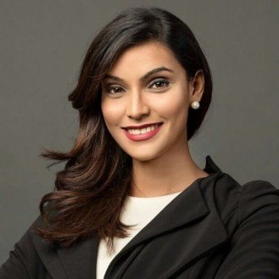 Stunning corporate headshot. The smile, how the hair folds to one side. It says professional and sharp.