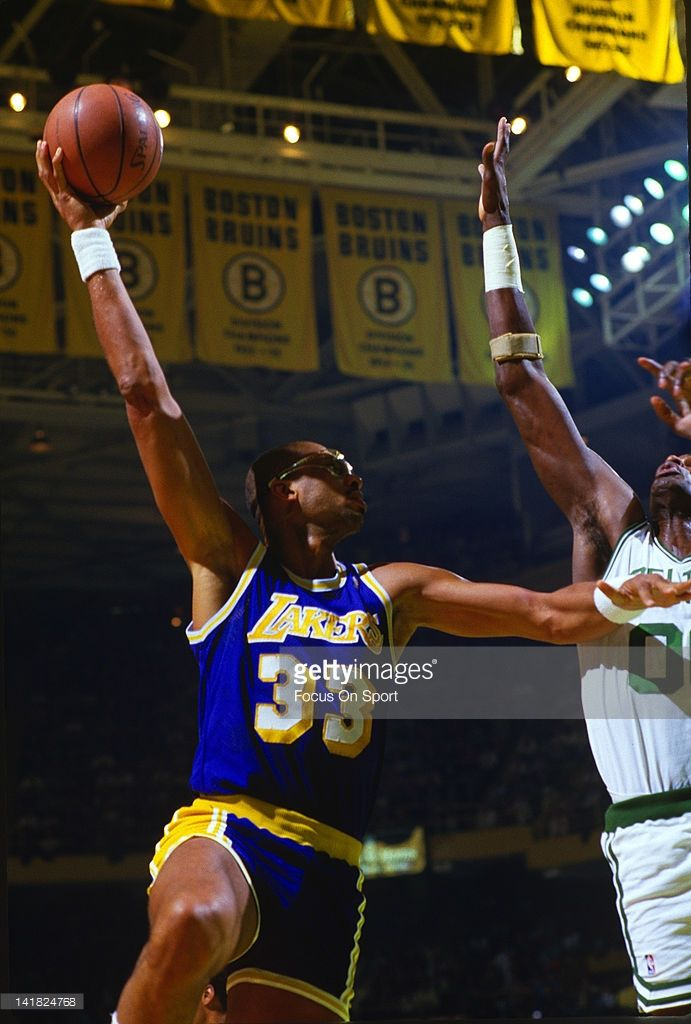 Kareem Abdul-Jabbar #33 of the Los Angeles Lakers shoots over Robert Parish #00 of the Boston Celtics during an NBA basketball game circa 1984 at The Boston Garden in Boston, Massachusetts. Abdul-Jabbar played for the Lakers from 1975-89.