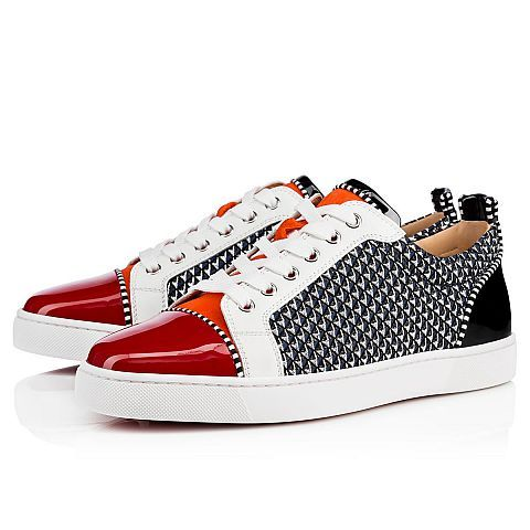 """For those who prefer to keep a low profile, """"Louis Junior Orlato Flat"""" is your gateway into the world of Louboutin. In this eclectic mix of flamenco and black patent with pyramid glitter fabric, the signature lowtop gets you from A to B in distinctive red sole style."""