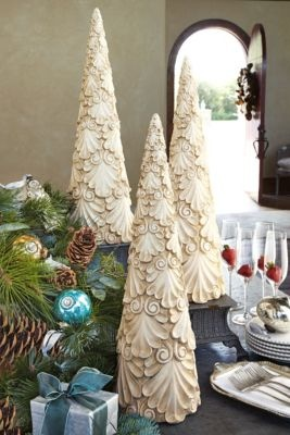 Winter Palace Tree from Soft Surroundings: I think this look could be made from salt dough using a cookie cutter, then shaped around a cone and carefully oven dried. Finished off with paint, a sealant and glued onto a cone form.