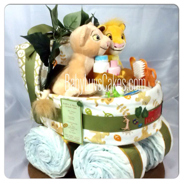 Simba and Nala bassinet diaper cake created for those of us who love the Lion King. Custom design by Diana Lee designer of BabyLuvsCakes diaper cakes