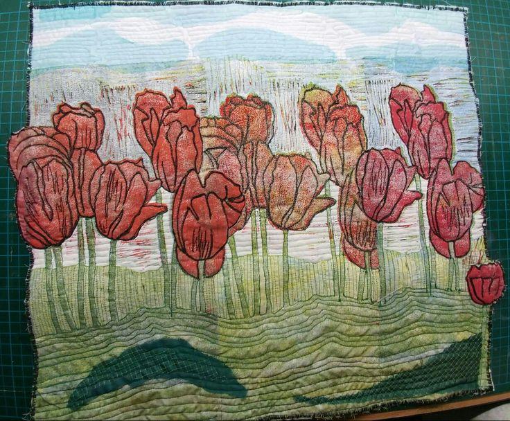 3 lappen met linosnede gemaakt tot één quilt