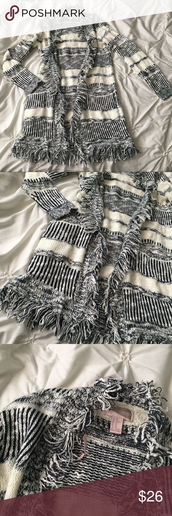 Forever 21 Black & White Striped Fringe  Sweater Forever 21 Black & White Striped Fringe Long Cardigan Sweater size XS ---- 🚭 All items are from a non-smoking home. 👆🏻Item is as described, feel free to ask questions. 📦 I am a fast shipper with excellent ratings. 👗I love bundles & bundle discounts. Feel free to make an offer! 😍 Like this item? Check out the rest of my closet! 💖 Thanks for looking! Forever 21 Sweaters Cardigans