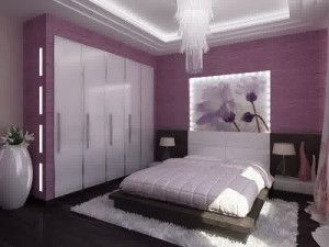 Small Bedrooms Decor: Royal purple bedrooms decor with purple wall and white ceiling and purple closet with 5 door white in addition jar and wood bed with white mattress and white fur carpet in addition to chandelier attractive