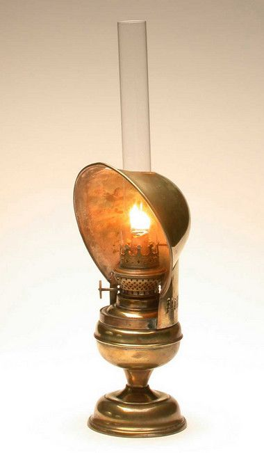 Victorian brass piano lamp with a long glass chimney to direct smoke away from the user, while playing the piano, reading or sewing.