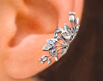 100% Sold Sterling Silver made buy RingRingRing. This leaf cartilage wrap ear cuff earrings is lightly antiqued by oxidized and polished to show the