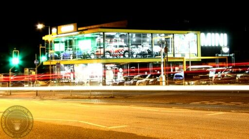 Its MINIS IN THE DARK tonight folks with this stunning shuttle delay shot of a MINI dealership. Very cool pic