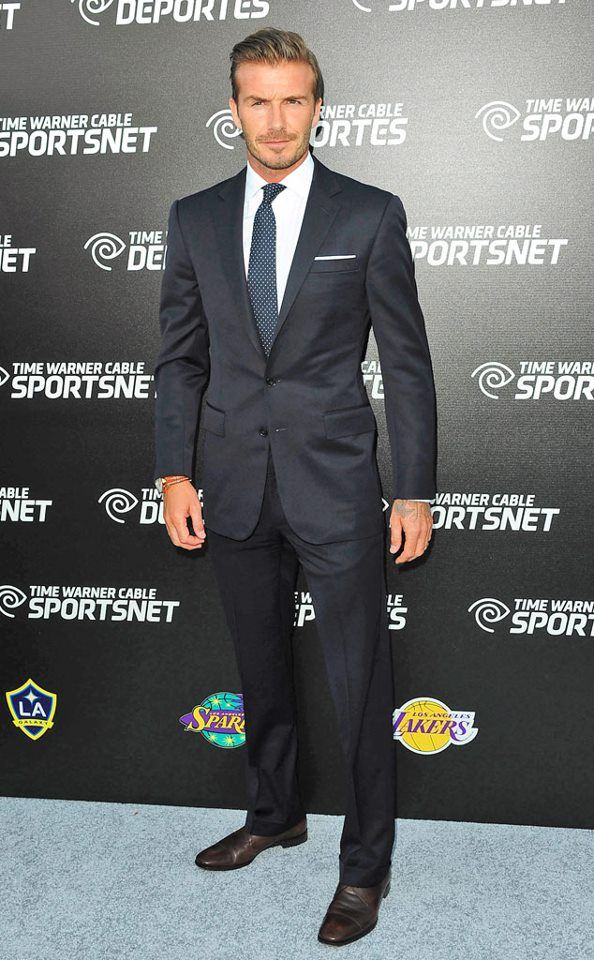 David Beckham. Hideous tattoos hidden, handsome man who carries a suit beautifully.