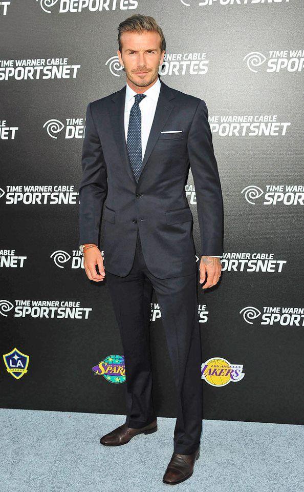 David Beckham. Hideous tattoos hidden, handsome man who carries a suit beautifully.
