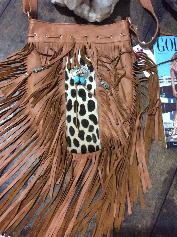 A personal favourite from my Etsy shop https://www.etsy.com/au/listing/467028576/tribe-hide-fringe-bag