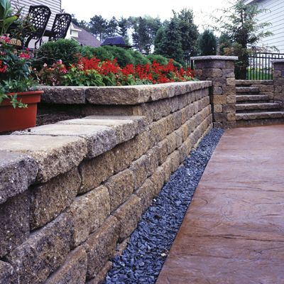 VERSA-LOK Standard retaining wall blocks (available at Nettleton Concrete) are just the beginning. Give them your own unique twist like this. www.nettletons.com